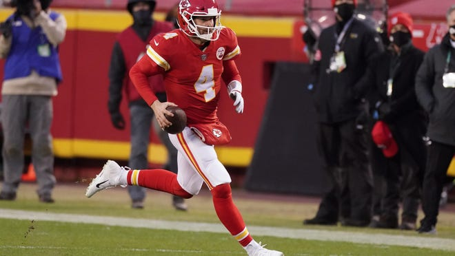 Kansas City Chiefs quarterback Chad Henne scrambles up field during the second half of an NFL divisional round football game against the Cleveland Browns, Sunday, Jan. 17, 2021, in Kansas City.