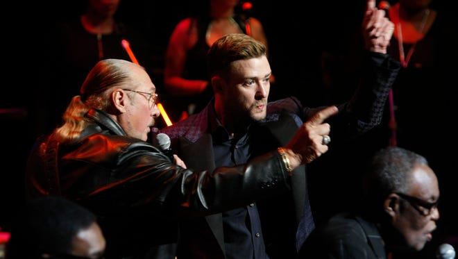 "Justin Timberlake, center, whistles the tune ""Sitting on the Dock of the Bay""  with Steve Cropper, left, during the Memphis Music Hall of Fame induction ceremony Saturday, Oct. 17, 2015, in Memphis, Tenn. (AP Photo/Karen Pulfer Focht)"