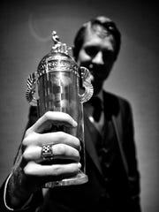 2014 Indy 500 champ Ryan Hunter-Reay shows off his new baby Borg Trophy.