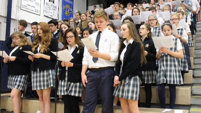 Students from across the Lafayette Catholic School System worship together during National Catholic Schools Week.
