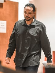 In this Nov. 9, 2016 file photo Alfredo David Castro is seen after his arraignment hearing at the Superior Court of Guam Northern Court Satellite in Dededo.