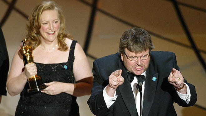 "Filmmaker Michael Moore accepts his Oscar for Documentry Feature for ""Bowling for Columbine"" during the 75th Academy Awards at the Kodak Theatre in Hollywood, California, 23 March 2003."