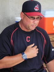 Cleveland Indians manager Terry Francona (17) looks on against the Milwaukee Brewers at Maryvale Baseball Park.