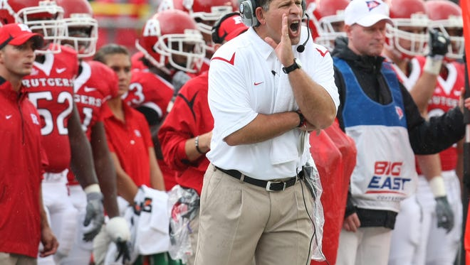 Former Rutgers coach Greg Schiano barks instructions to his players. Now he will be coaching against Rutgers at Ohio State.