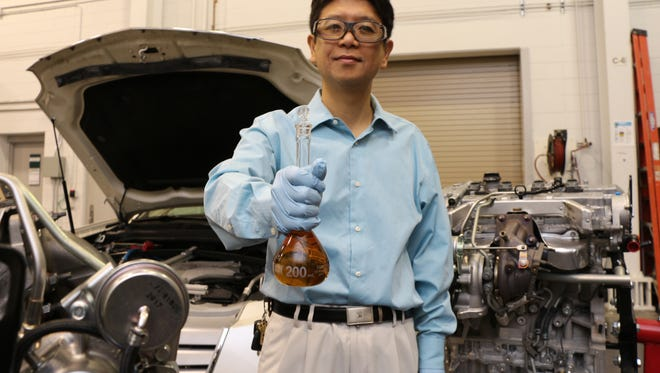 Resercher Jun Qu developed a fuel-saving oil additive at Oak Ridge National Laboratory, near Knoxville, Tenn. The result is a low-cost substance that appears to reduce the fuel consumption of any engine at least 2%.