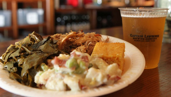 Pulled pork, potato salad, greens and corn bread was on the menu during  last year's pig roast event at Captain Lawrence Brewery in Elmsford.