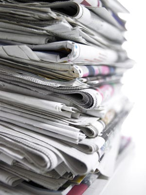 Stack of newspapers for online.