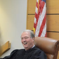 In this 2012 photo, then-Judge James Kingsley enjoys a moment during a surprise ceremony.