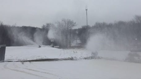 Snow is blown from snow making machines at Granite Peak Ski Area on Nov. 22.