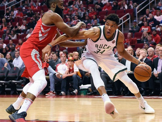 Milwaukee Bucks forward Giannis Antetokounmpo (34) drives as Houston Rockets guard James Harden defends during the first half of an NBA basketball game, Saturday, Dec. 16, 2017, in Houston. (AP Photo/Eric Christian Smith)