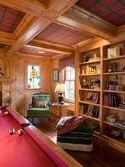 The elegant pool table lined with red rather than the