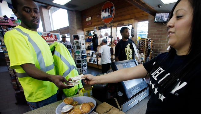 Powerball tickets were flying out the door at Fuel City in Dallas on Feb. 10, 2015.