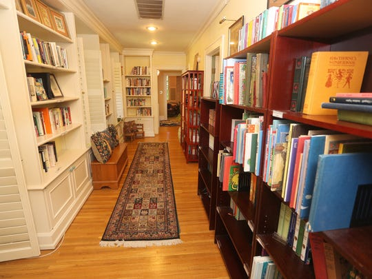 This long hallway doubles as a reading and library area in this Brighton home built in 1829.
