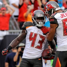 Tampa Bay Buccaneers running back Bobby Rainey (43) celebrates a touchdown with wide receiver Vincent Jackson (83) as the Carolina Panthers beat the Buccaneers 20-14 at Raymond James Stadium.
