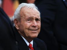 """Arnold Palmer brought a country-club sport to the masses with a hard-charging style, charisma and a commoner's touch. """"The King"""" died Sunday in Pittsburgh. He was 87."""