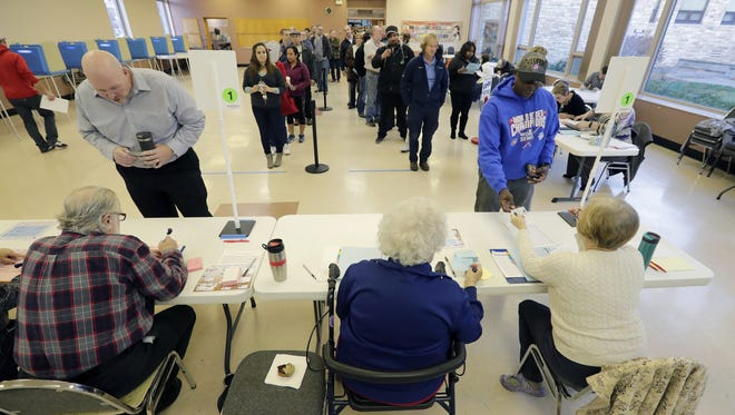 Long lines of residents wait to receive their voting ballots Tuesday, November 8, 2016, at First United Methodist Church in Appleton, Wisconsin.