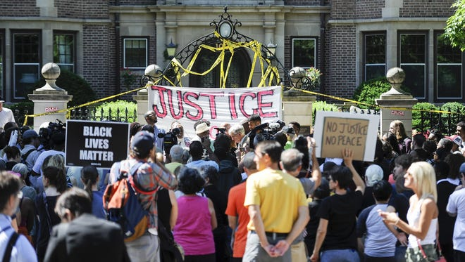 Protesters gather in front of the Minnesota governor's residence in St. Paul in reaction to the police shooting of Philando Castile.