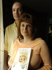 """A file photo of Lorraine Ash, author of """"Life Touches Life, A Mothers Story of Stillbirth and Healing"""" at her home in Allendale with her husband Bill."""