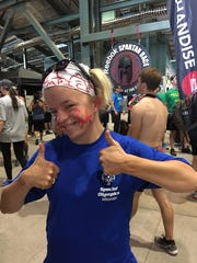 Daina Shilts ran in her first Spartan Race, and represented Wisconsin Special Olympics.