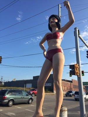 In summer-attire mode, Vanna Whitewall stands sentinel next to Peoria Plaza Tire, 1800 SW Washington St.