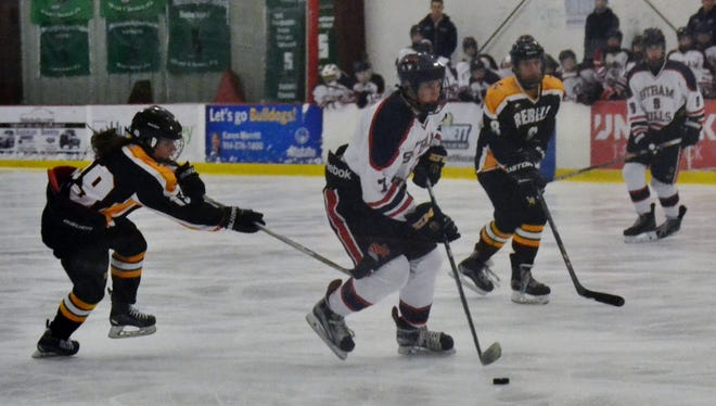 Byram Hills defenseman Robert Lunder (7) brings the puck into the offensive zone Friday during a 12-4 win over Lakeland/Panas.