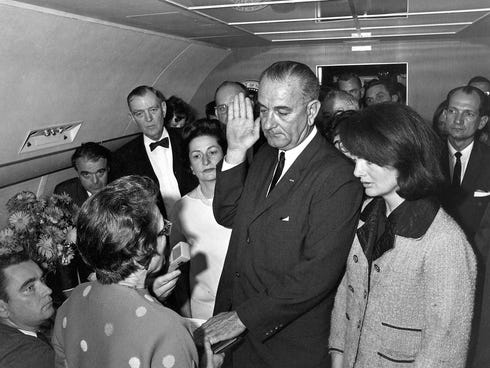 Lyndon Johnson is sworn in as president as Jacqueline Kennedy stands at his side in the cabin of the presidential plane on the ground at Love Field in Dallas. Judge Sarah T. Hughes, a Kennedy appointee to the Federal court, left, administers the oath