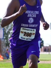 A Mescalero runner makes his way toward the finish line.