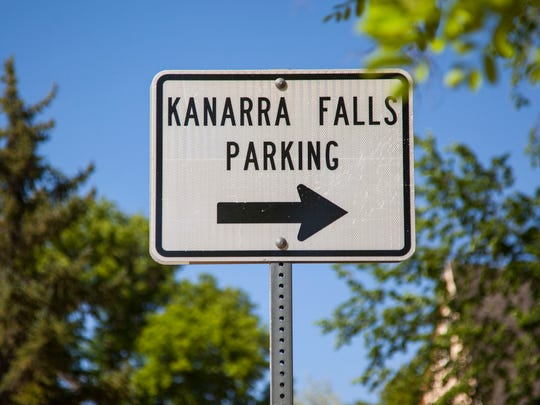 A sign on Main Street in Kanarraville directs visitors to designated parking areas to hike the falls.