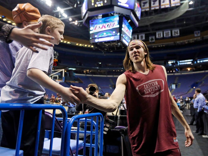 Eastern Kentucky's Eric Stutz greets fans after practice at the NCAA college basketball tournament Thursday, March 20, 2014, in St. Louis. Eastern Kentucky is scheduled to play against Kansas in a second-round game on Friday. (AP Photo/Jeff Roberson)