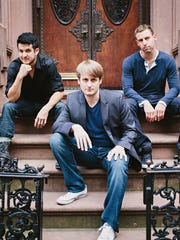 Time for Three -- Nicolas Kendall (from left), Zach De Pue and Ranaan Meyer -- will perform with the Indianapolis Symphony Orchestra at Thursday's finale for this season of Happy Hour at the Symphony at Hilbert Circle Theatre.