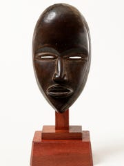 """""""Face Mask""""  is a late 19th–early 20th century work by Dan peoples, Côte d'Ivoire,  in wood. It is part of the Barnes Foundation collection."""