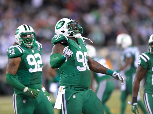 FILE - In this Nov. 12, 2015, file photo, New York Jets defensive end Muhammad Wilkerson (96) celebrates after making a tackle against the Buffalo Bills during an NFL football game in East Rutherford, N.J. Wilkerson, Sheldon Richardson and Leonard Williams are back to anchor the defense. (AP Photo/Bill Kostroun, File)
