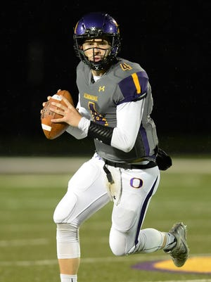 Oconomowoc quarterback Benjamin Nienhuis completed 22 of 37 passes for 338 yards and three touchdowns Thursday in a loss to Wisconsin Lutheran.