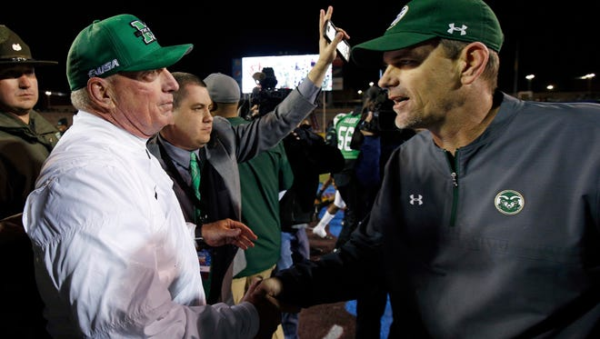 Marshall coach Doc Holliday, left, is congratulated by Colorado State coach Mike Bobo after Marshall's 31-28 win in the New Mexico Bowl Saturday.