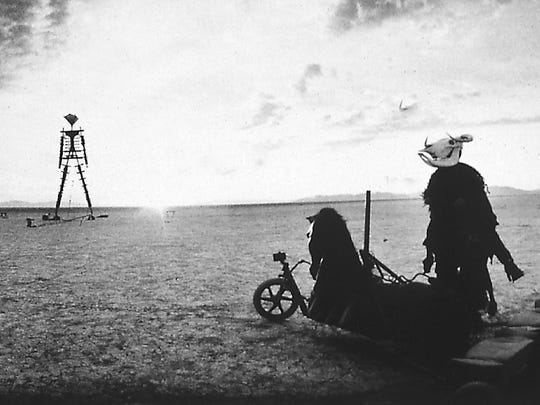 Beelzebub greets the Burning Man at dawn during the 1996 festival.