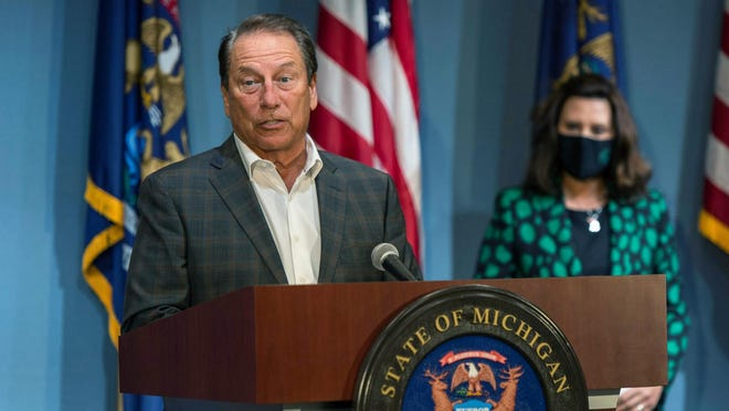 Michigan State men's basketball coach Tom Izzo, standing next to Gov. Gretchen Whitmer, addresses the state, Wednesday in Lansing. Izzo, along with women's coach Suzy Merchant and University of Michigan women's coach Kim Barnes Arico joined the governor at a news conference to push mask wearing.