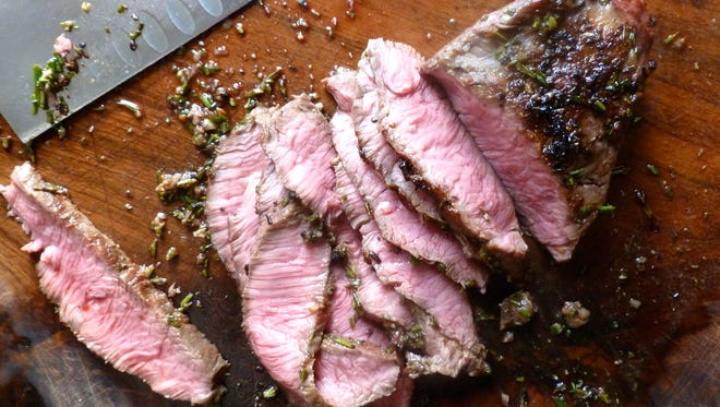 Grilled flatiron steak with Hickory Nut Gap meat, rubbed with rosemary and other spices.