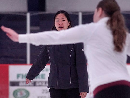 Coach Angella Keller works with 12-year-old student