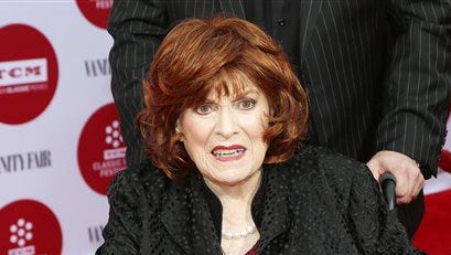 In this file photo, Maureen O'Hara arrives at 2014 TCM Classic Film Festival's Opening Night Gala at the TCL Chinese Theatre in Los Angeles.  The Academy of Motion Picture Arts and Sciences will present Honorary Awards to Jean-Claude Carrière, Hayao Miyazaki and O'Hara, and the Jean Hersholt Humanitarian Award to Harry Belafonte.  All four awards will be presented at the Academy's 6th Annual Governors Awards on Saturday at the Ray Dolby Ballroom at Hollywood & Highland Center in Los Angeles.