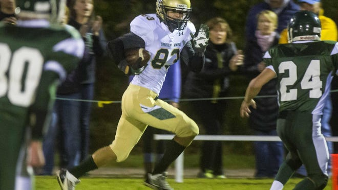 Mount St. Joseph's Jonah Farrow runs for extra yards against Winooski during the 84-70 victory in September. MSJ is merging with Poultney in a cooperative agreement the VPA approved last week.