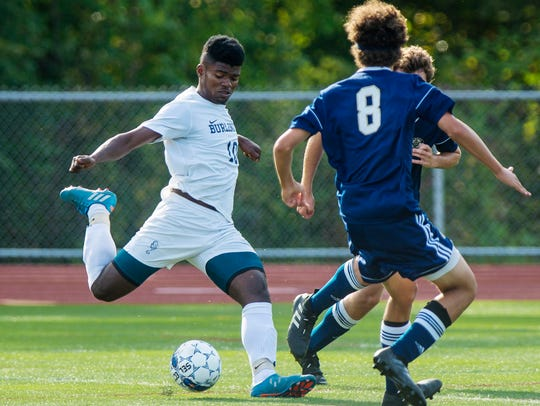 Burlington's Bienfait Badibanga fires on goal against