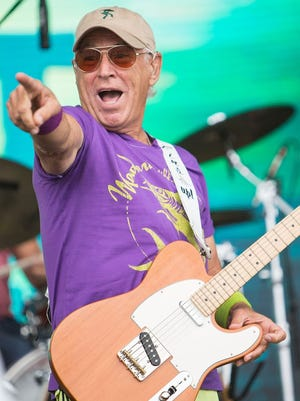 Jimmy Buffett performs on stage at FinFest on August 9, 2014 in Hermosa Beach, California.