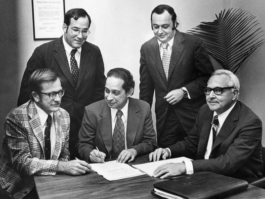Officials of University School of Nashville sign papers purchasing their building, the former Peabody Demonstration School, from Peabody College on Sept. 30, 1976. Seated are Dr. Jim Hays, left, Leonard Esstman and Frank Farris Jr. Standing are Stuart Blankstein, left, and Stanley Chernau.