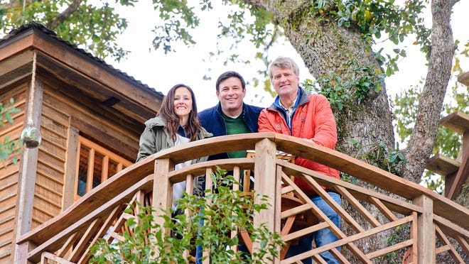 """Gwen and Todd Graves with Pete Nelson, famed treehouse designer and builder. The treehouse will be featured on an upcoming episode of Animal Planet's """"Treehouse Masters."""""""