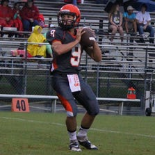 The Zephyrhills' QB Ty Tanner looks for an open receiver during warmup before the game against the South Sumter Raiders.
