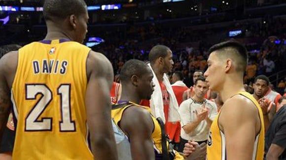 Lakers forward Julius Randle is greeted by teammates