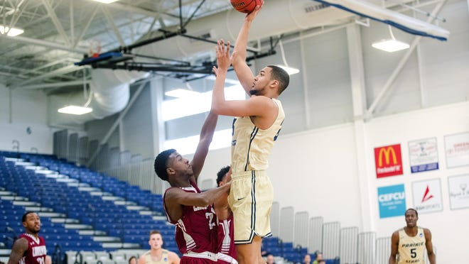 UIS' Collin Stallworth  elevates for a shot over Lindenwood's Jahkeal Samuel at UIS Wednesday Dec. 19, 2018.