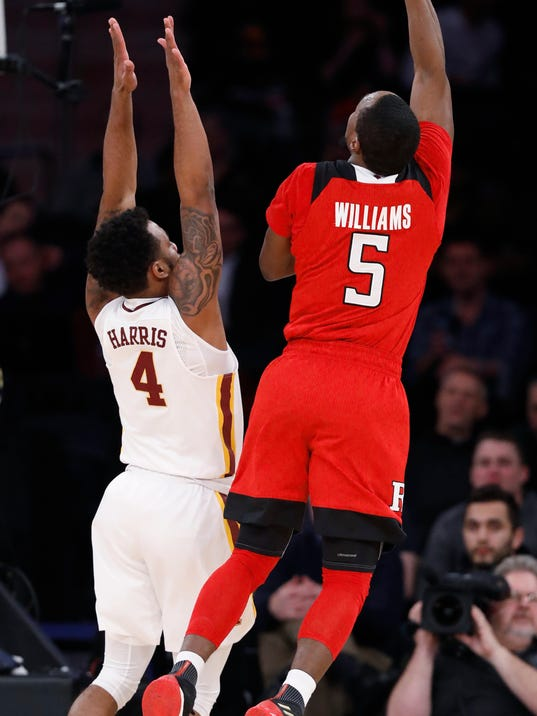 Rutgers guard Mike Williams (5) shoots as Minnesota guard Jamir Harris (4) defends during the first half of an NCAA college basketball game in the first round of the Big Ten men's tournament Wednesday, Feb. 28, 2018, in New York. (AP Photo/Kathy Willens)