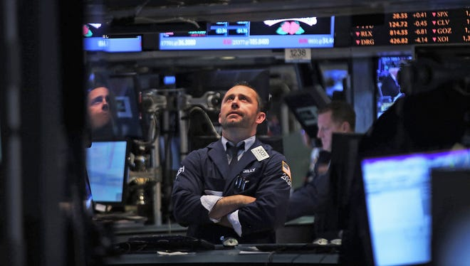 Traders watch the action on the floor of the New York Stock Exchange Wednesday.