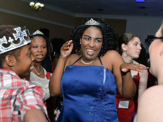 "Jeffrica Hall, center, ""cuts a rug"" on the dance floor for the Tim Tebow Foundation's ""Night to Shine."" The Treasure Coast's Night to Shine '80s Murder-Mystery Dinner is Friday at Genesis Community Church in Fort Pierce."